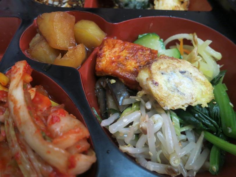 Close-up of kimchi, potatoes and tofu