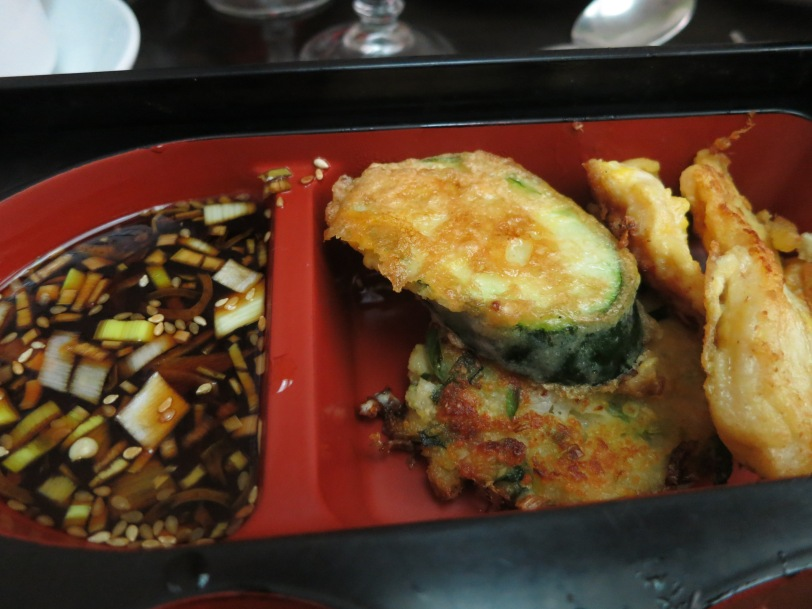 Closeup of tempura vegetables and sauce