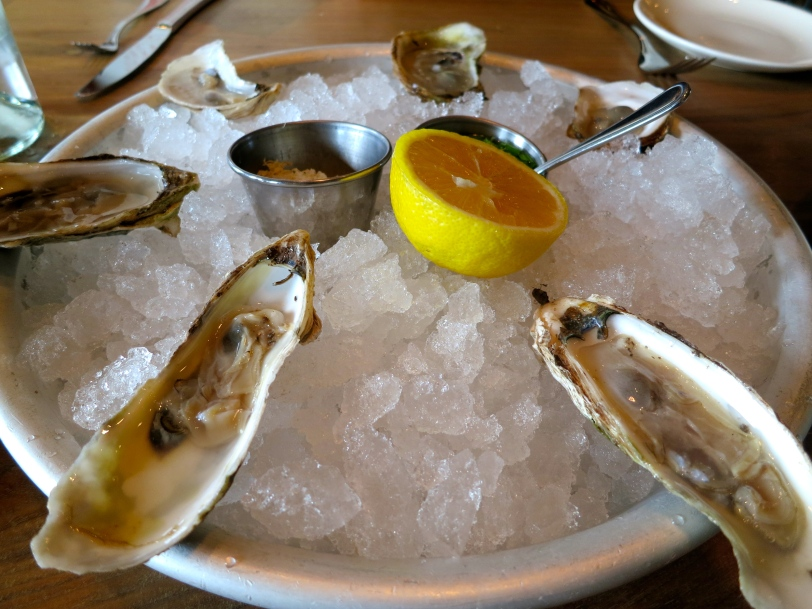 East coast oysters on ice with fresh horseradish and mignonette