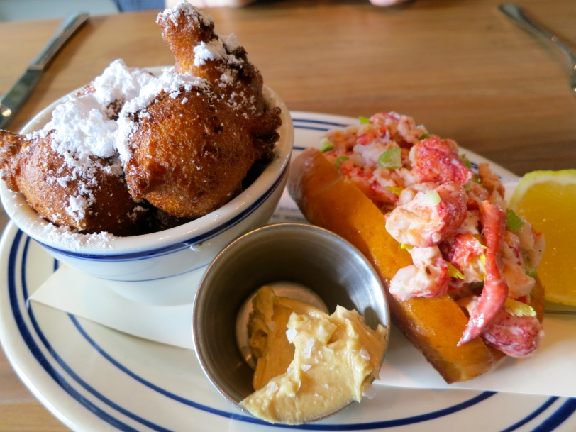 "Maine lobster roll with a side of ""beignet style"" cornmilk hushpuppies with cane syrup butter"