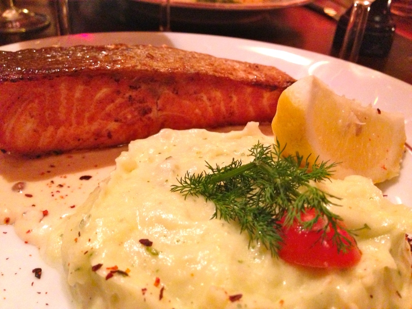 Salmon with goat cheese cream sauce and side of mashed potatoes